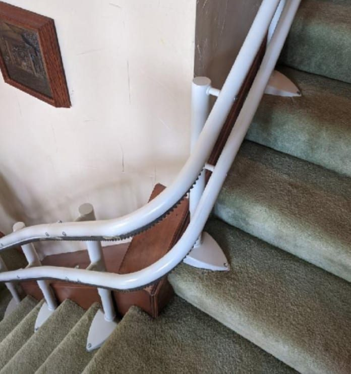Handicare 2000 stairlift rail curved around a landing