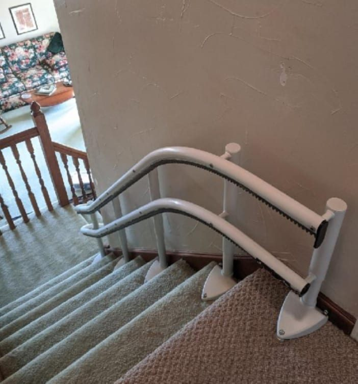Handicare 2000 stairlift rail installation at the top of the steps